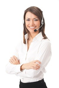 customer support person with headset on the telephone